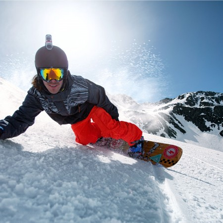 TomTom Bandit Action Camera - Snowboarder gliding down hill
